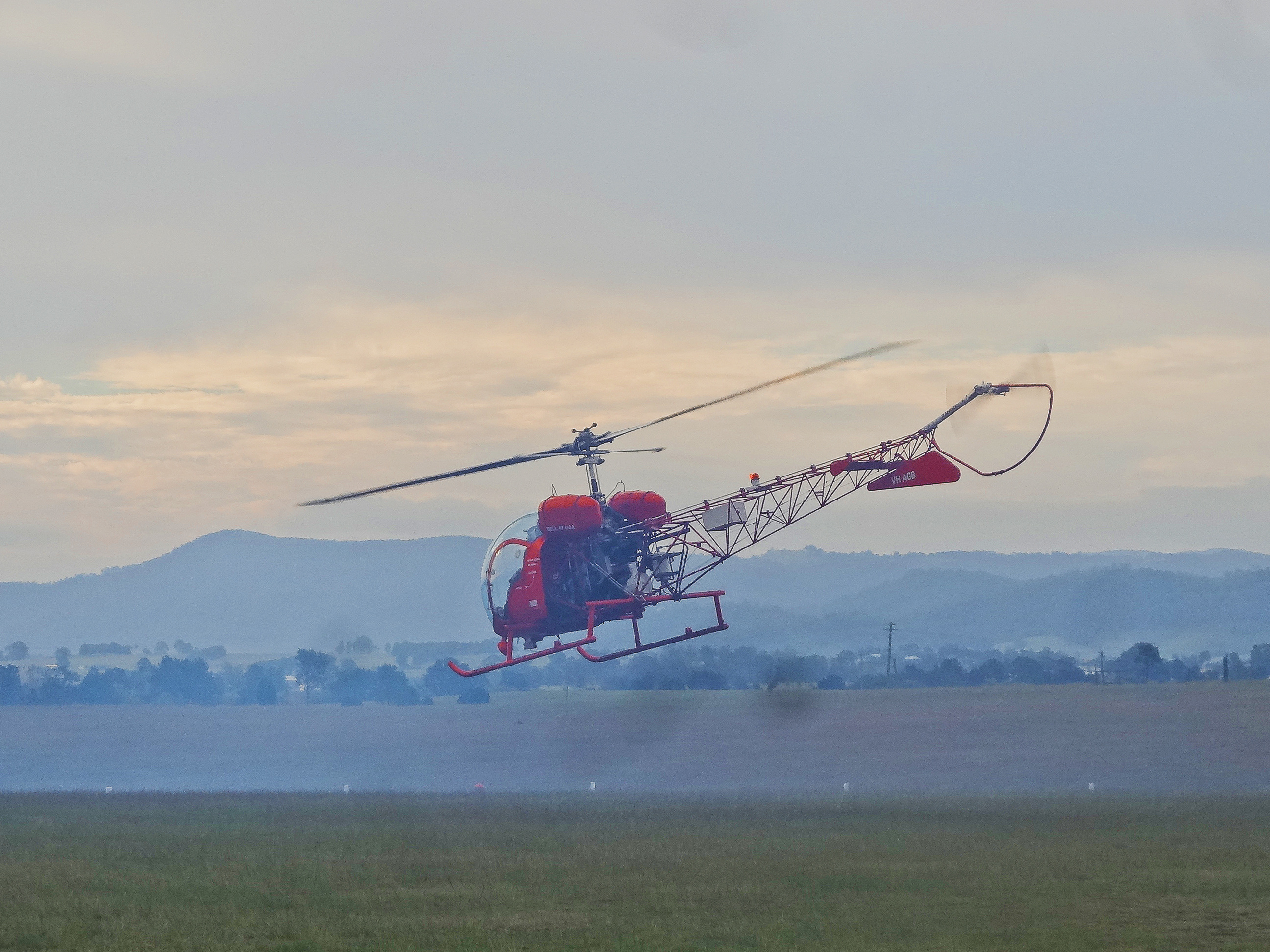 Bell 47 taking off with smoke