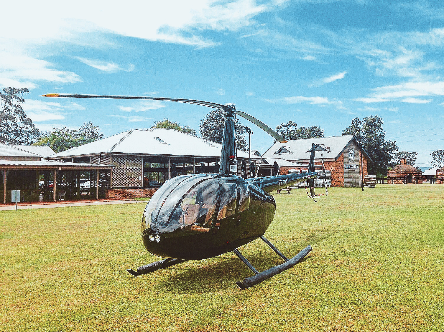 VH-WTT R44 at potters brewery